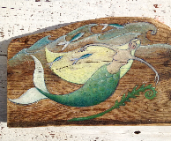 Painting on a wooden panel of a Dorset mermaid by Michelle Hazell